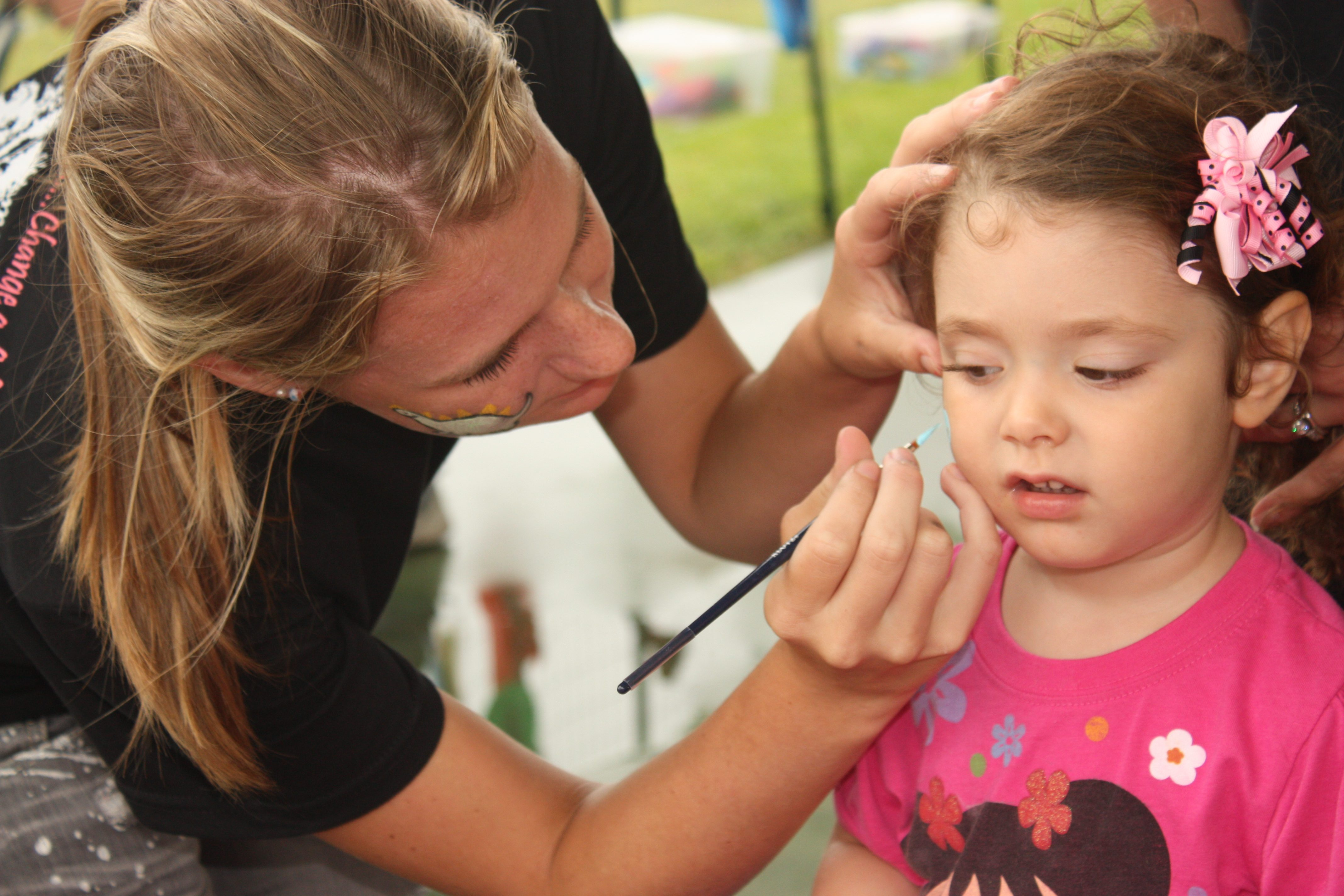 Face painting is one of many family activities to enjoy at the annual Haynie Spirit Festival and BBQ Fundraiser, which this year raised more than $8,000. Photo by Sydney Long, courtesy of the Haynie Spirit Bone Cancer Foundation.