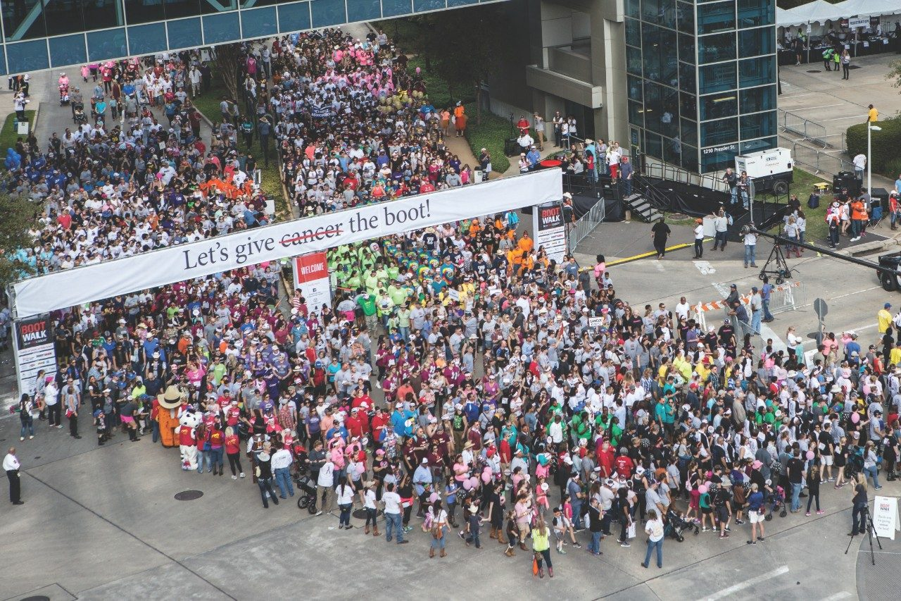 "The inaugural Boot Walk to End Cancer™, a 1.2 mile walk to ""give cancer the boot,"" drew approximately 7,000 cancer survivors, families and friends and raised more than $905,0000. Proceeds will support MD Anderson's mission to end cancer."