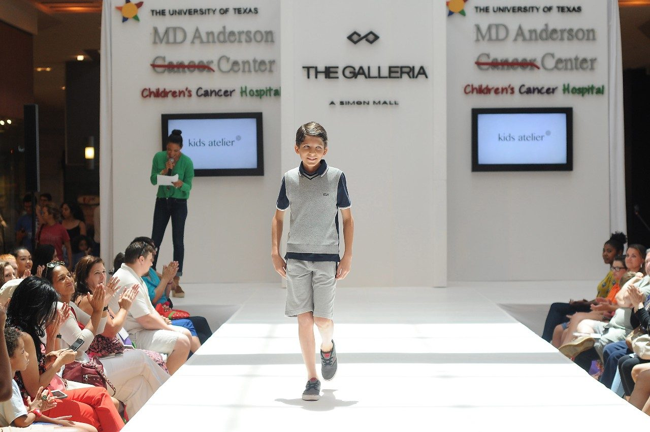 Pediatric cancer patients enjoy the runway at The Houston Galleria in front of family and friends.