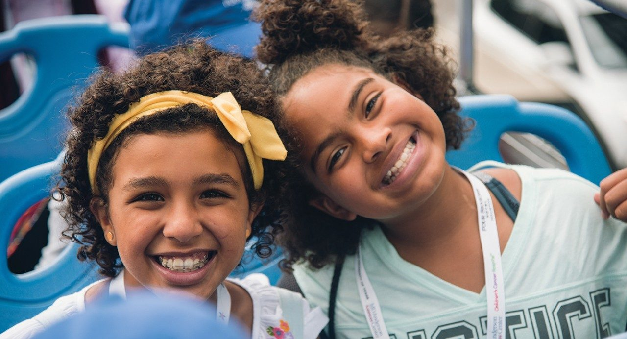 Patients Lara Amer and Ava Gallien share a smile during the Camp H-Town welcome party.