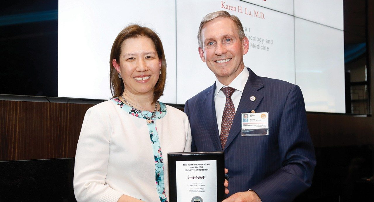 Karen Lu, M.D. accepts the Mendelsohn Award from MD Anderson President Peter Pisters, M.D.
