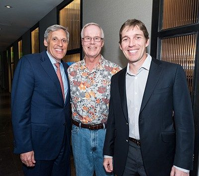 Tom Segesta, from left, Mark Rolfing and Nathan Stedham enjoy the evening at the Four Seasons' Topgolf® Swing Suite. Photo by Adolfo Chavez III