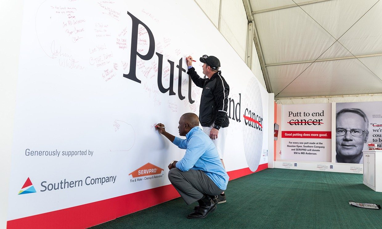 From left: Chris Womack of Southern Company and Chad Lewis of SERVPRO show their support of the Putt to End Cancer campaign. Photo by Adolfo Chavez III