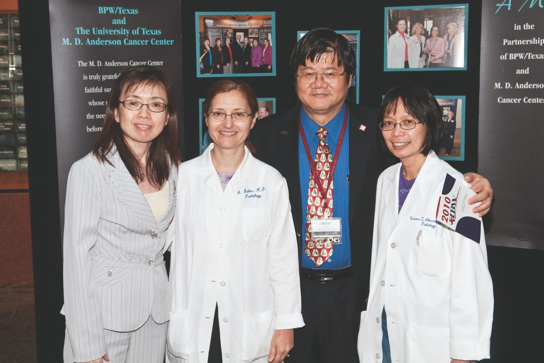 From left, Dihua Yu, M.D., Ph.D., professor of molecular and cellular oncology, pauses after receiving this year's TBW Award with Aysegul A. Sahin, M.D., professor pathology, Mien-Chie Hung, Ph.D., chair of the Department of Molecular and Cellular Biology; and Constance Albarracin, M.D., associate professor of pathology. Photo by Barry Smith.