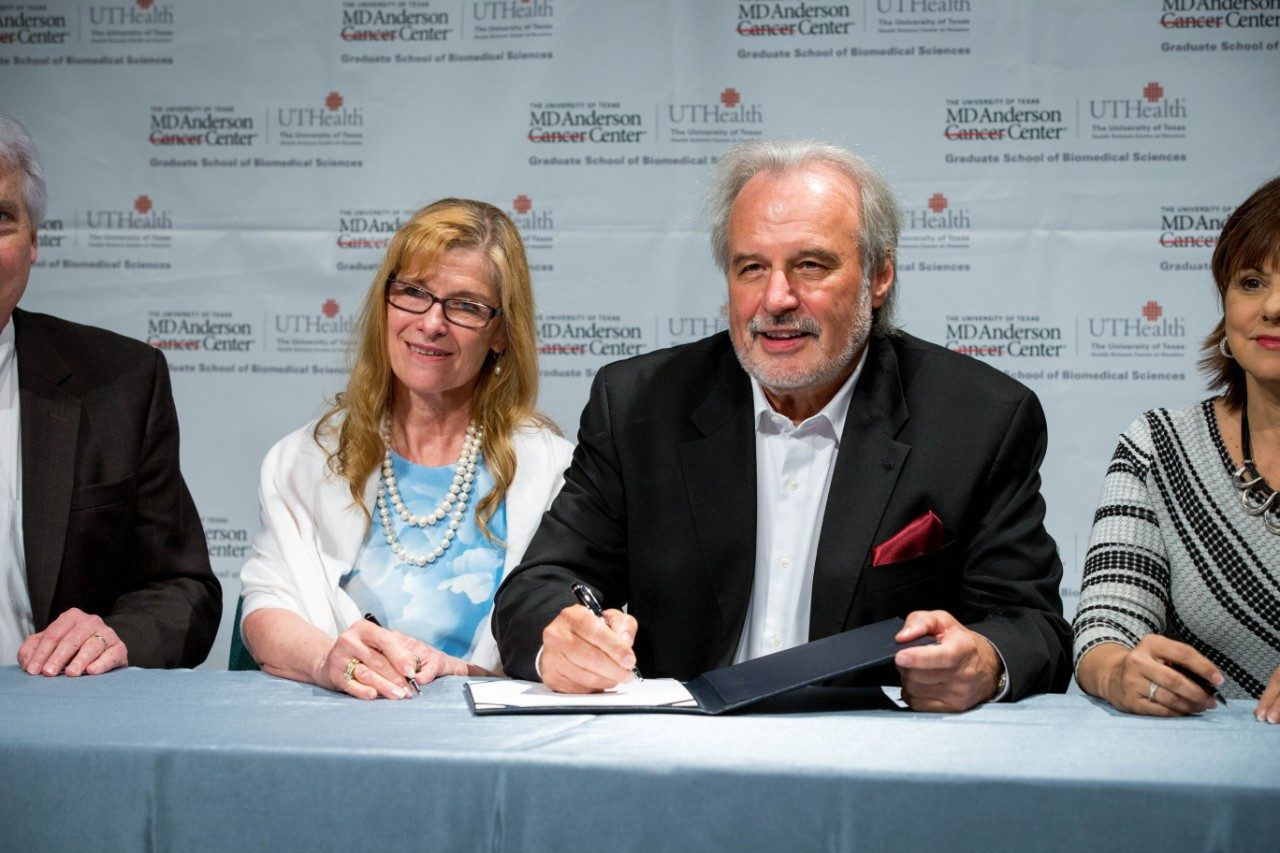Charline and John Kopchick, Ph.D., sign a $10.5 million gift agreement establishing the Dr. John J. Kopchick and Charlene Kopchick Endowed Fellowships at the MD Anderson UTHealth Graduate School.