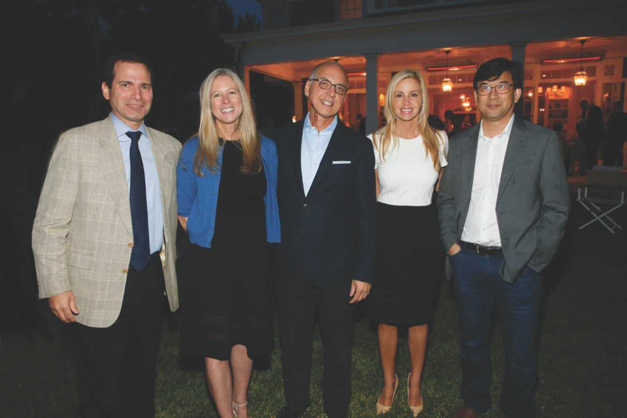 Erich Sturgis, M.D., from left, Susan and Chris Damico, Camille Grammer and Cassian Yee, M.D., pause for a quick photo at a reception in Los Angeles, California aimed at raising awareness about The University of Texas MD Anderson Cancer Center.