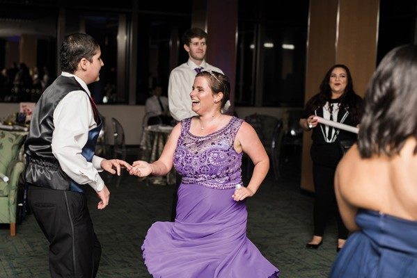 Patient Madalyn Russek and her date show off fancy footwork.