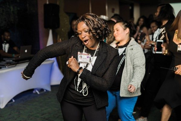 Theda Williams, program manager, Pediatrics, enjoys the party as much as teens.