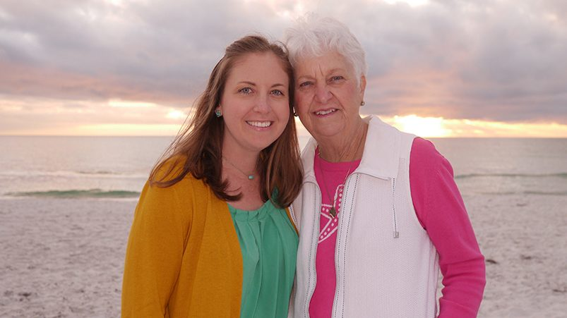 Christen Howell and Susan Stoddard on a beach at sunset