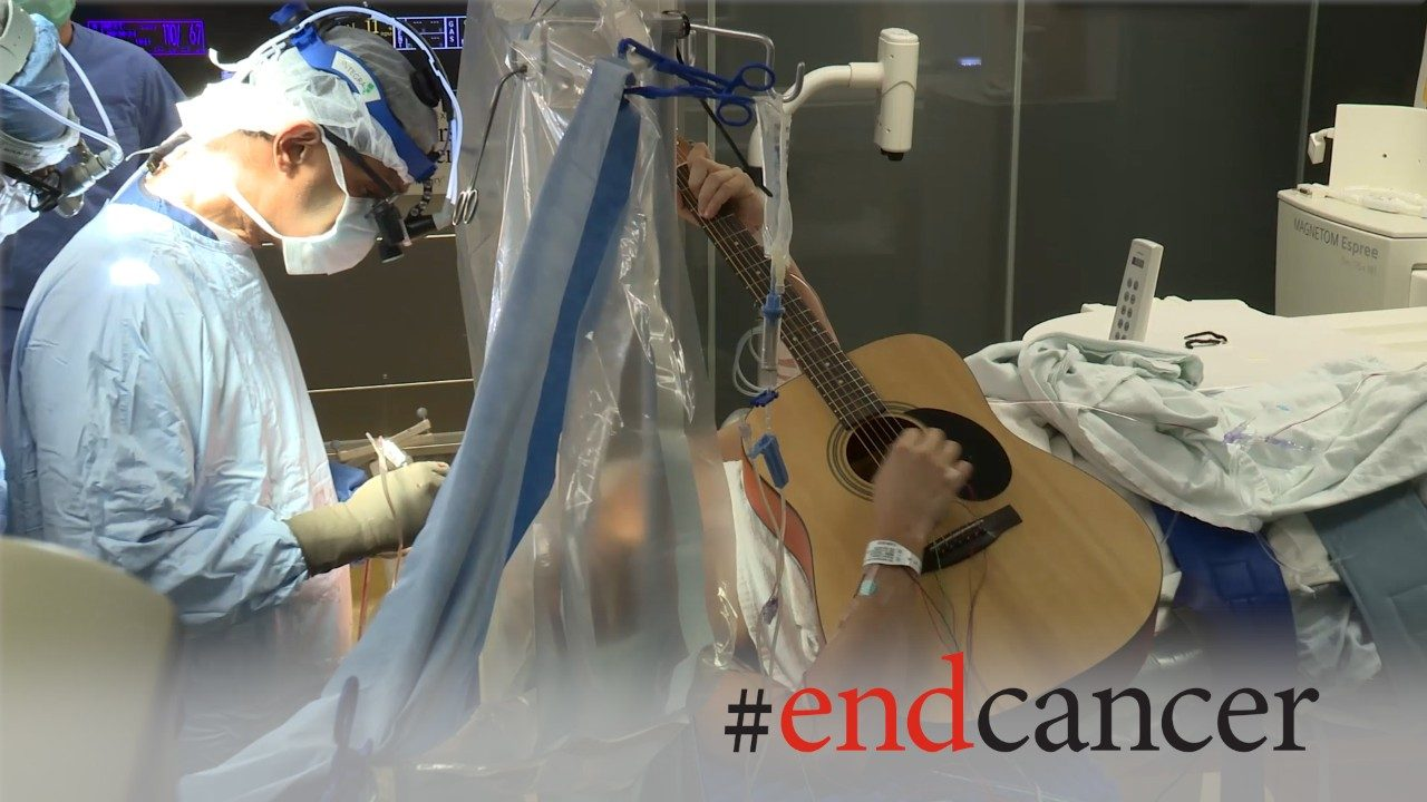 Brain tumor patient plays guitar during awake craniotomy